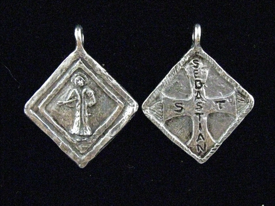 Sports jewelry st sebastian patron of athletes because sebastian an officer in the roman guards practiced his christianity openly he was charged with worshiping a aloadofball Images